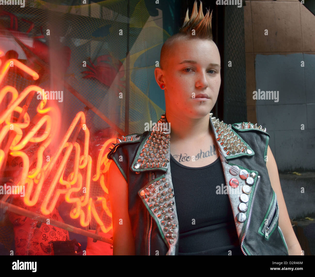 Portrait of Olivia with a spike mohawk hairdo. In the East Village, Manhattan, New York City - Stock Image