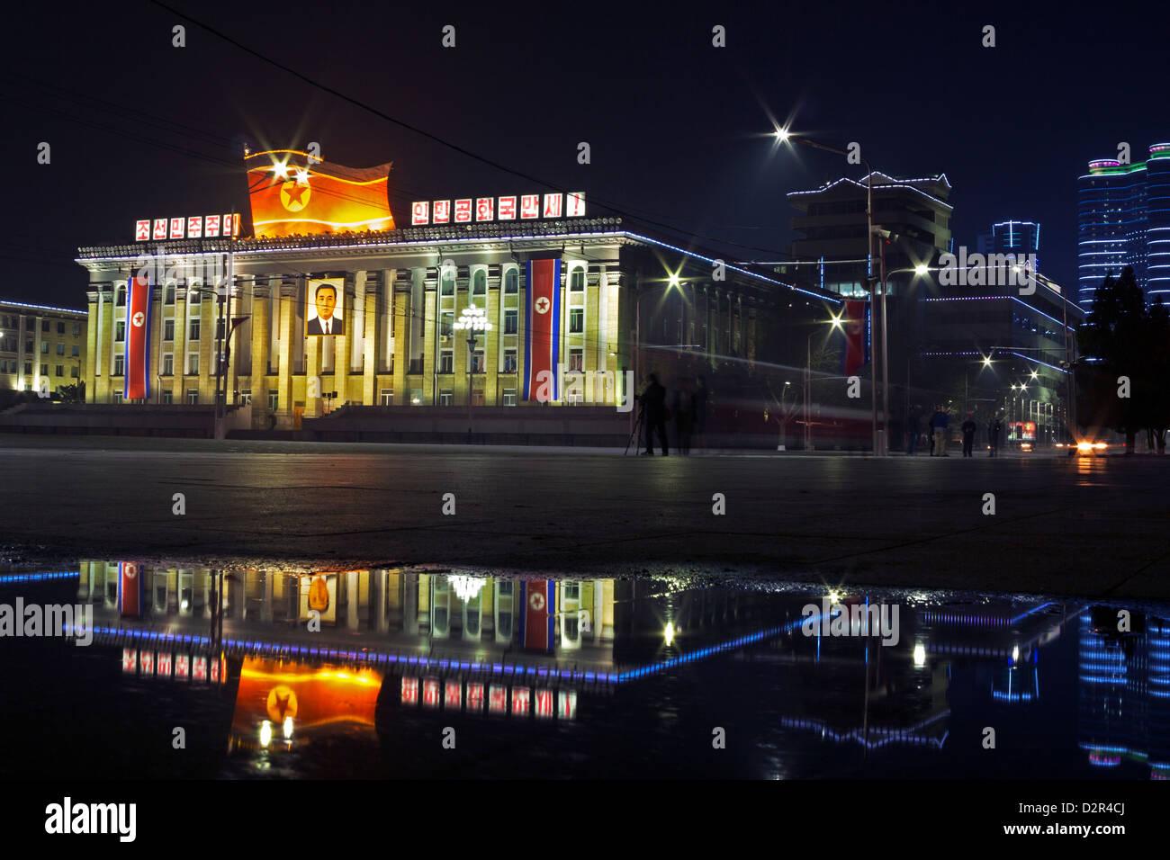 Kim Il Sung Square, illuminated at night, Pyongyang, Democratic People's Republic of Korea (DPRK), North Korea, - Stock Image