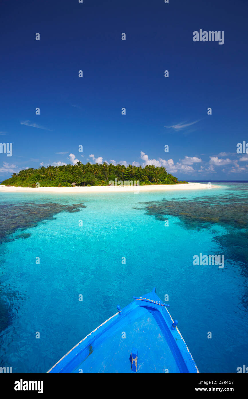 Boat heading for desert island, Maldives, Indian Ocean, Asia Stock Photo