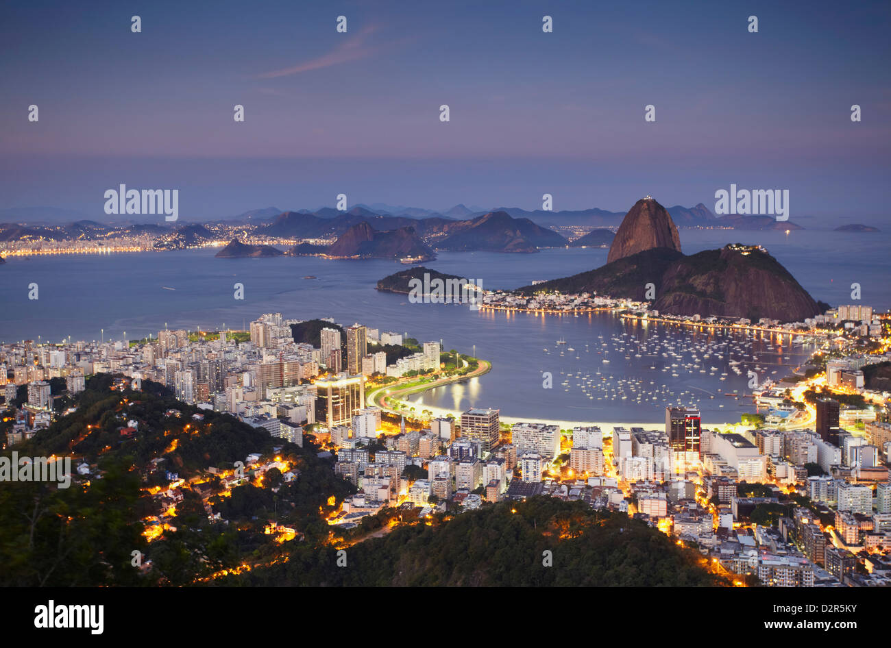 View of Sugar Loaf Mountain (Pao de Acucar) and Botafogo Bay at dusk, Rio de Janeiro, Brazil, South America Stock Photo