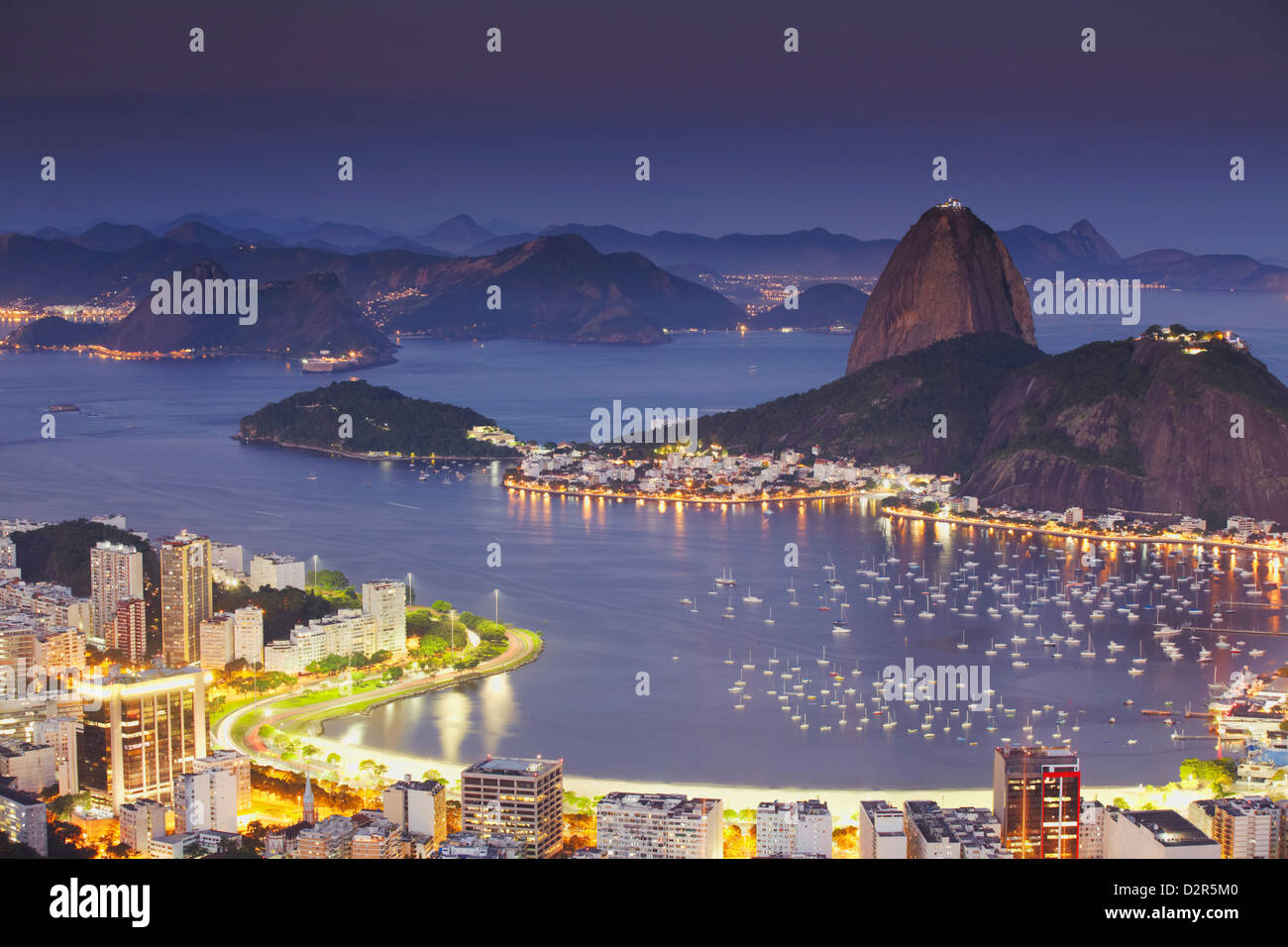 View of Sugar Loaf Mountain (Pao de Acucar) and Botafogo Bay at dusk, Rio de Janeiro, Brazil, South America - Stock Image