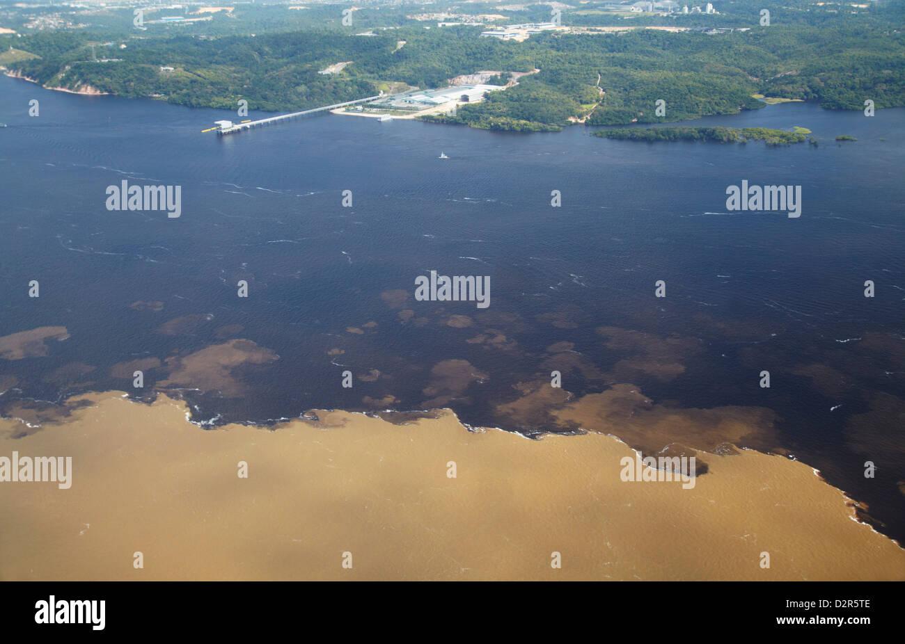 Aerial view of Encontro das Aguas, meeting of the Rio Negro and Rio Solimoes, Manaus, Amazonas, Brazil, South America - Stock Image