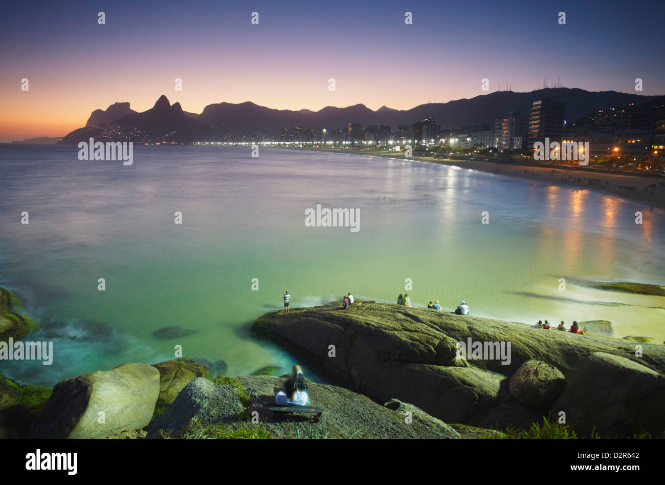 View of Ipanema beach at sunset from Ponta do Arpoador, Ipanema, Rio de Janeiro, Brazil, South America - Stock Image