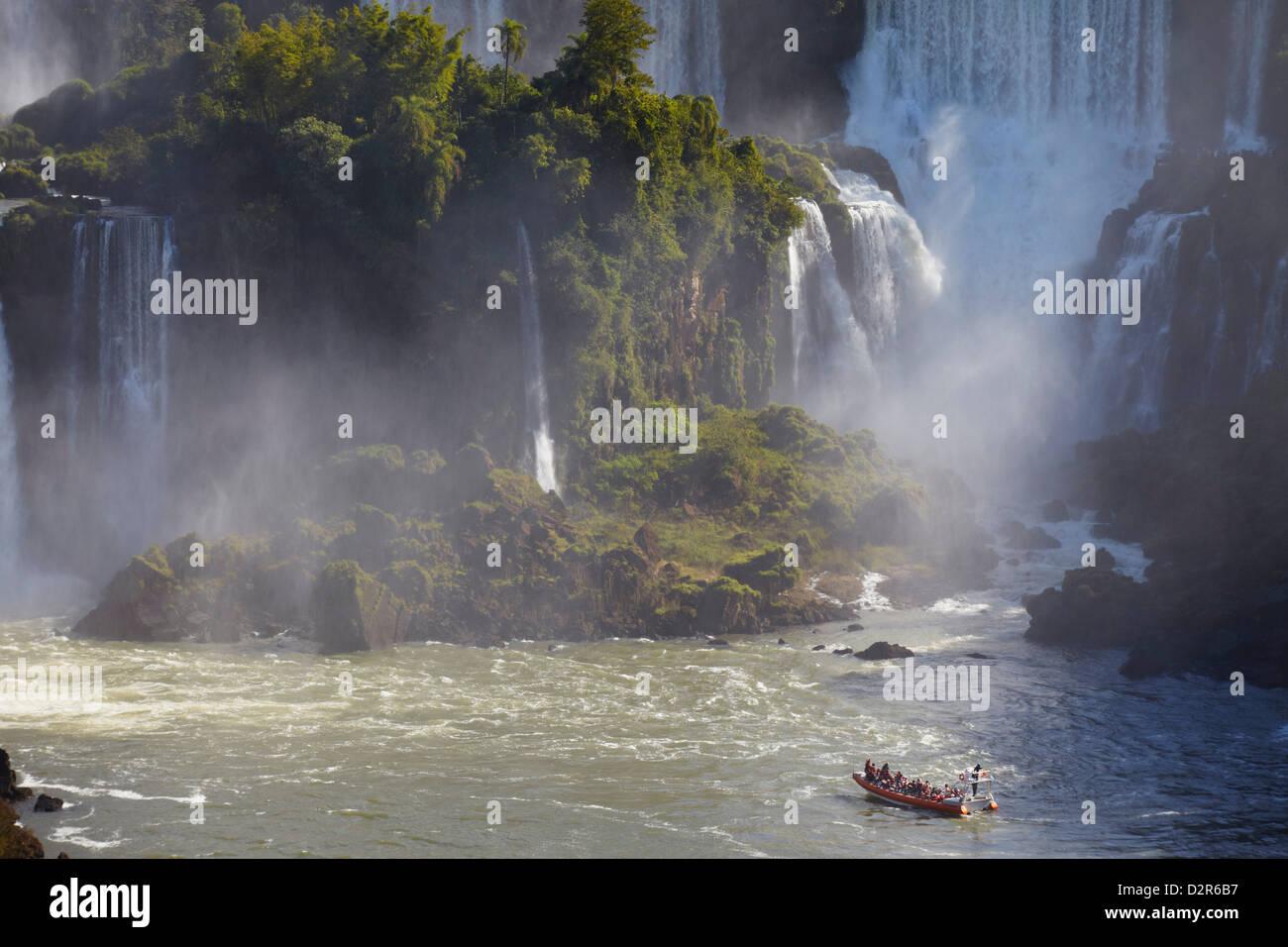 Tourist boat approaching Argentinean side of Iguacu Falls, Iguacu National Park, Parana, Brazil - Stock Image