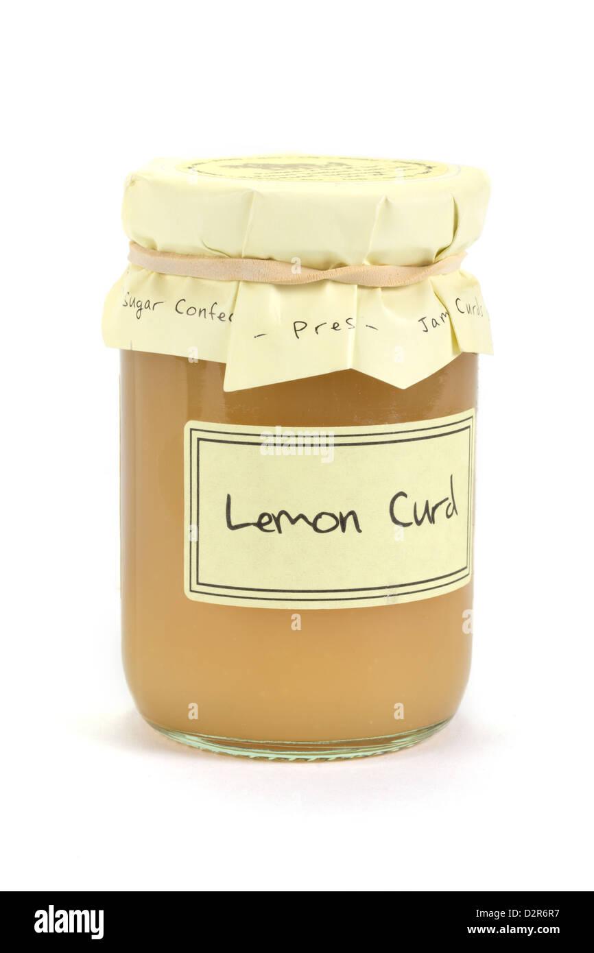 Jar of home made lemon curd over white - Stock Image