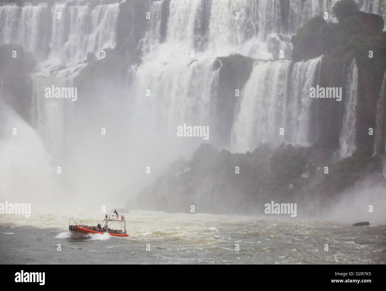 Tourist boat at Iguazu Falls, Iguazu National Park, UNESCO World Heritage Site, Misiones, Argentina, South America - Stock Image