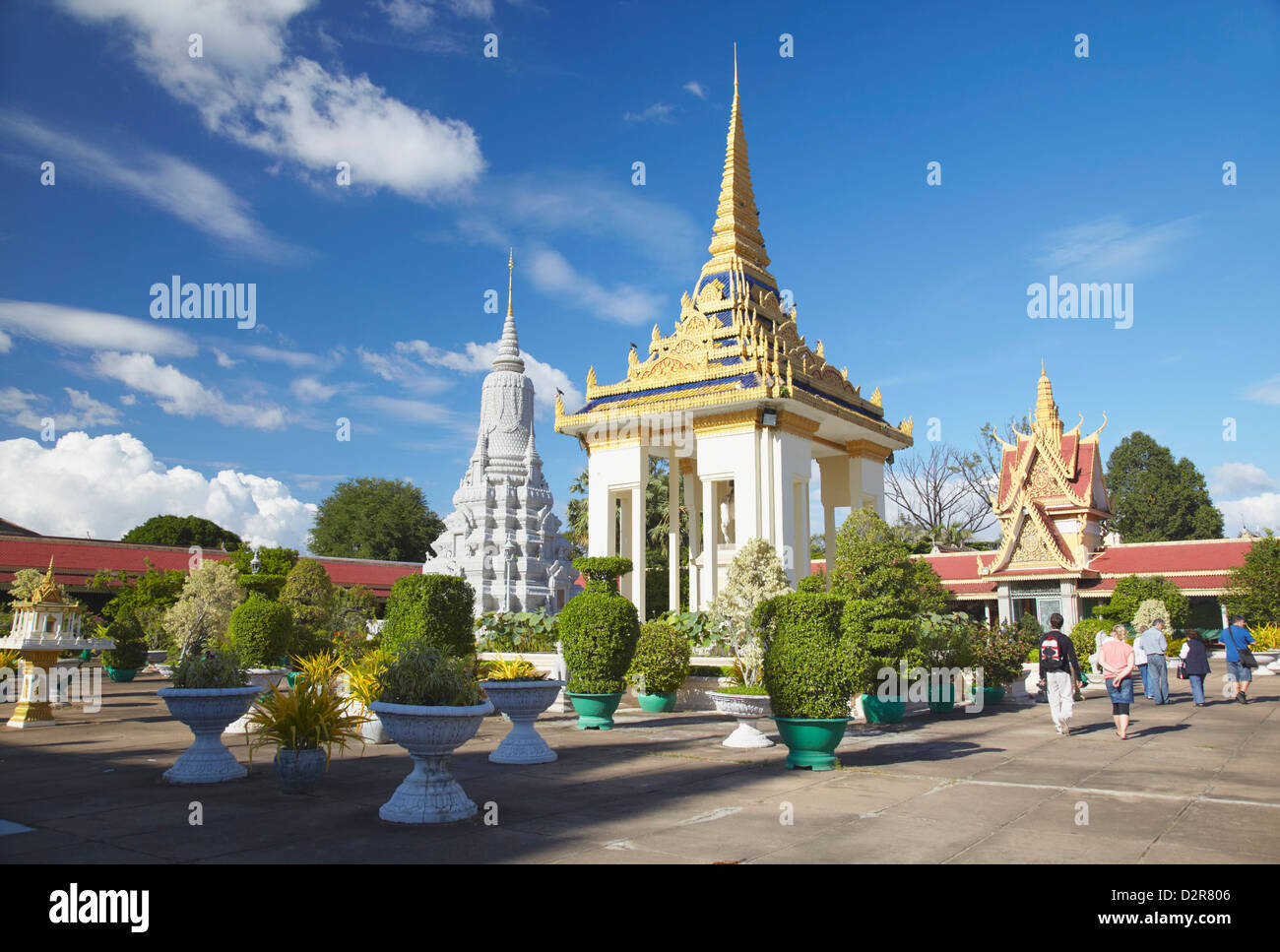 Tourists in grounds of Silver Pagoda in Royal Palace, Phnom Penh, Cambodia, Indochina, Southeast Asia, Asia - Stock Image