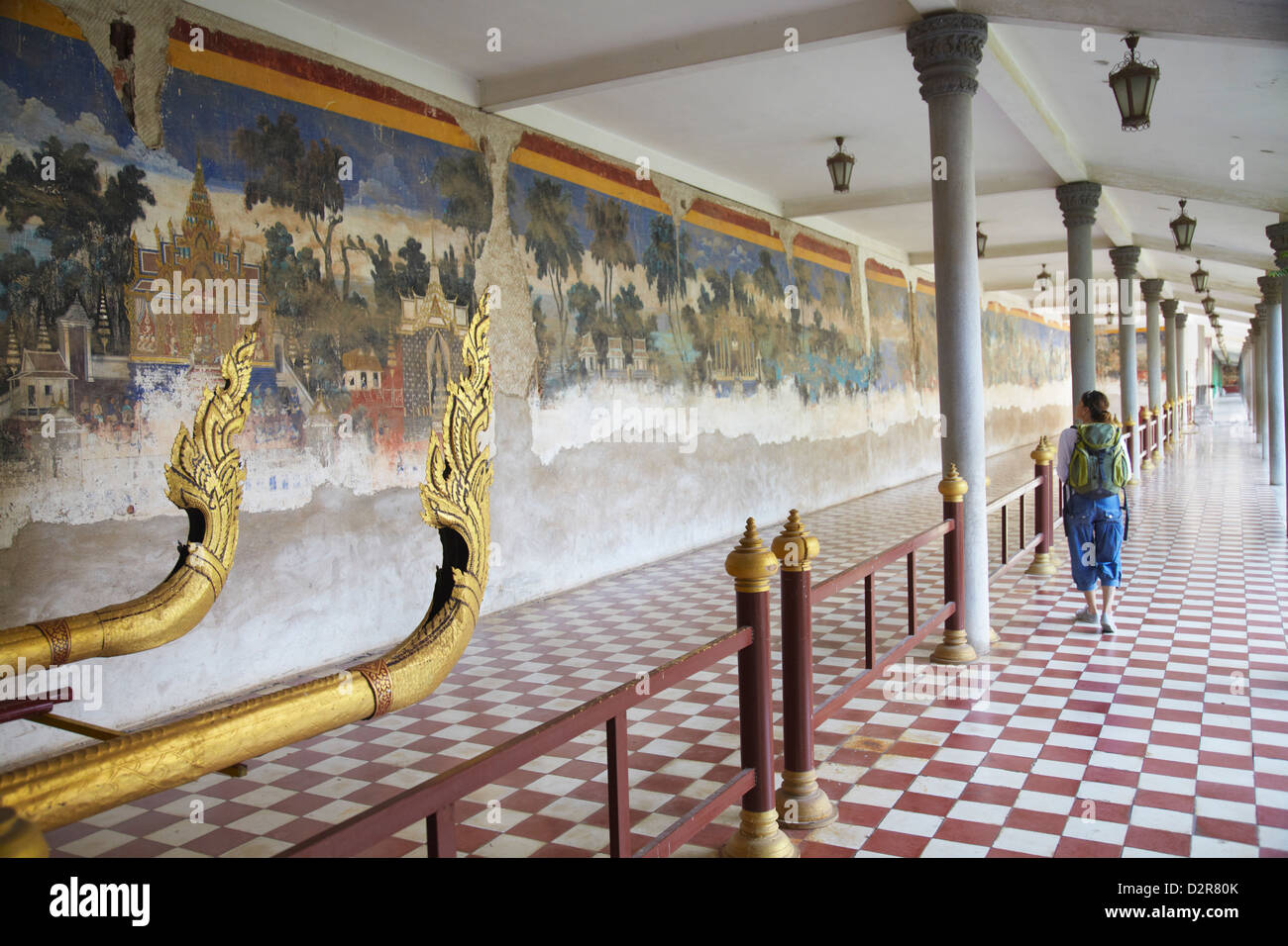 Woman looking at murals at Silver Pagoda in Royal Palace, Phnom Penh, Cambodia, Indochina, Southeast Asia, Asia - Stock Image