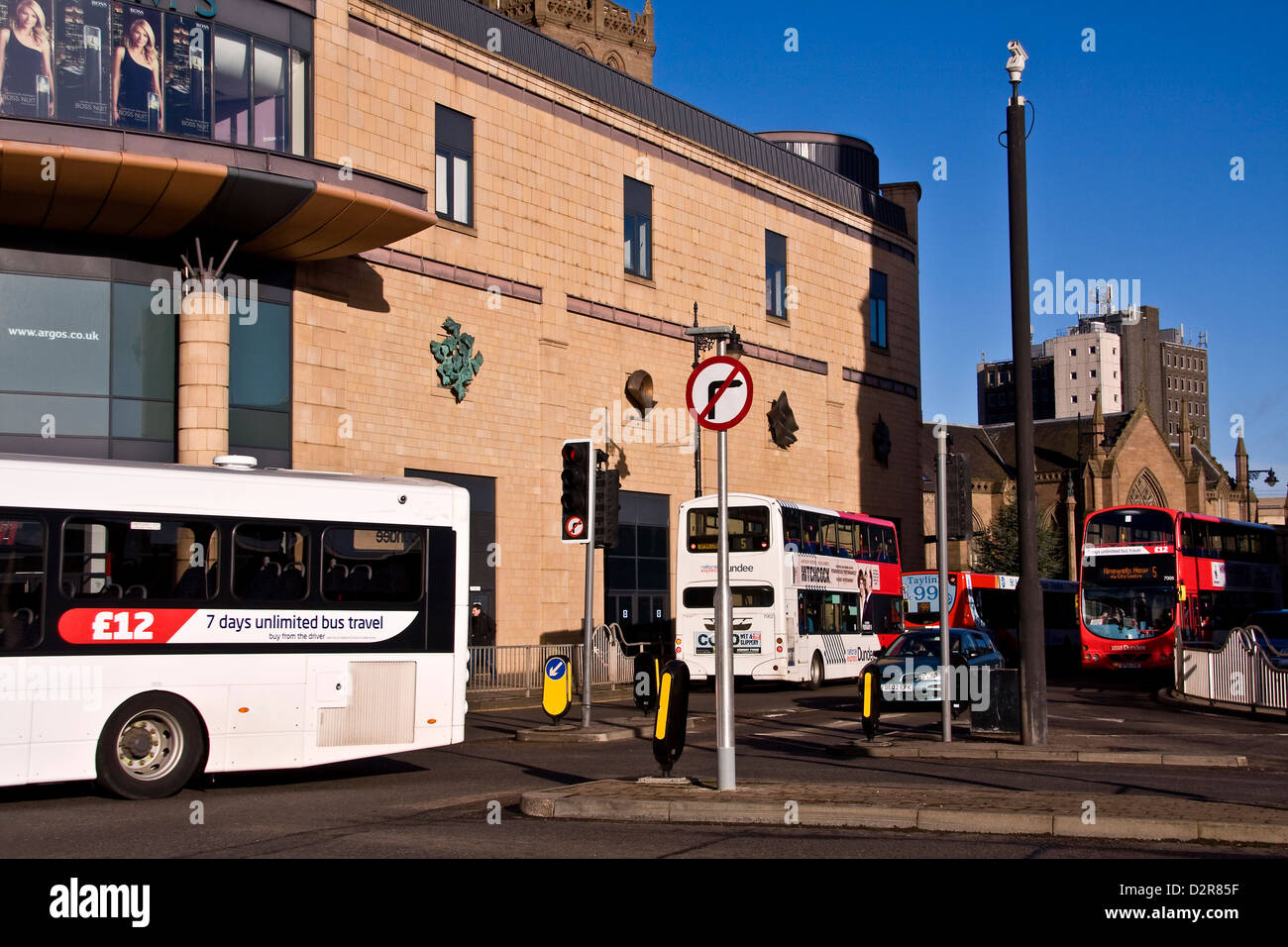 City Buses displaying 7day unlimited travel for £12 while travelling past the Overgate shopping centre in Dundee,UK - Stock Image