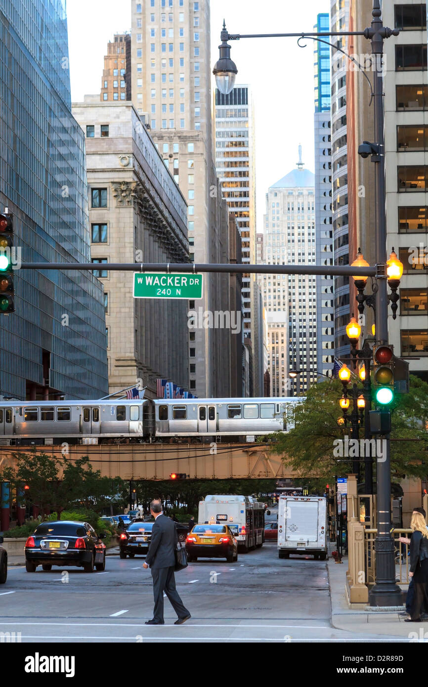 El train crossing North Clark Street, The Loop, Chicago, Illinois, United States of America, North America - Stock Image