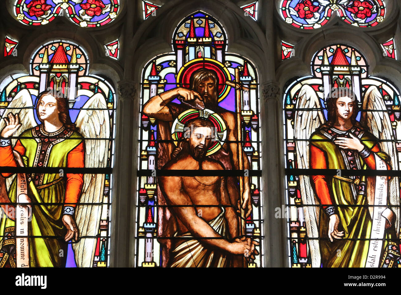 Stained glass window depicting the Baptism of Jesus by John the Baptist, St. Germain l'Auxerrois church, Paris, - Stock Image