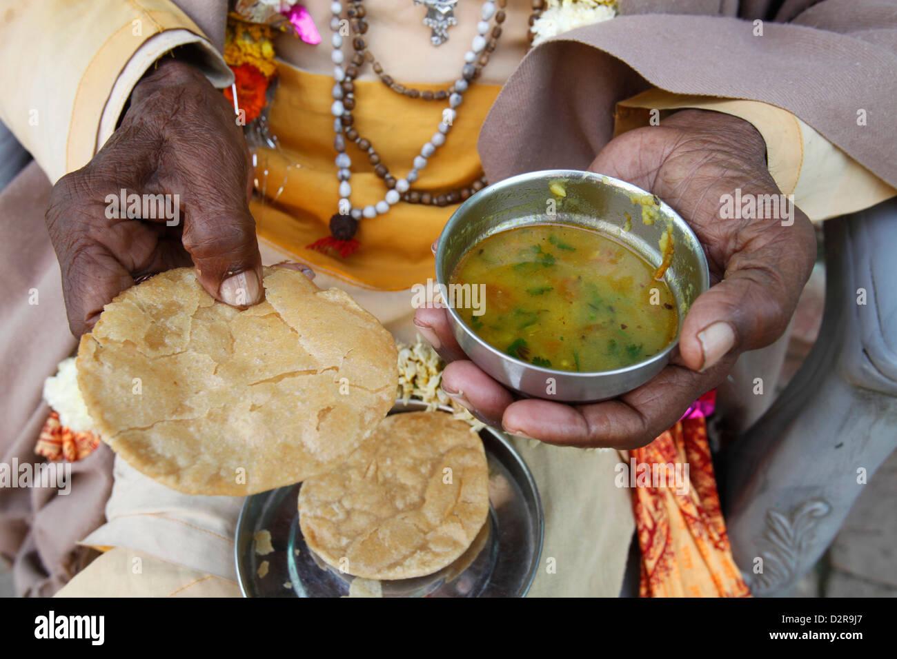 Sadhu eating vegetarian food, Dauji, Uttar Pradesh, India, Asia - Stock Image