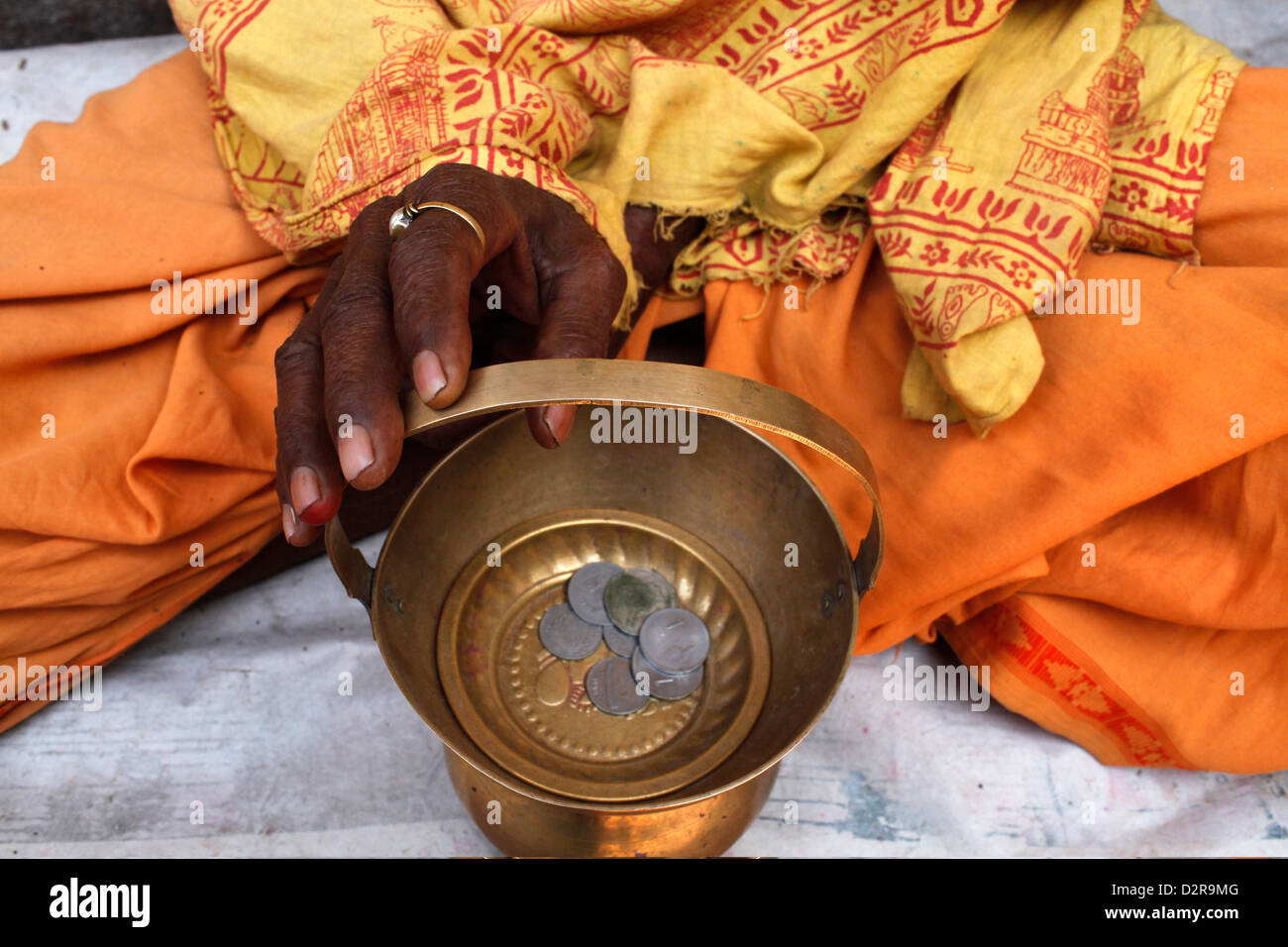 Holy man begging outside a temple, Vrindavan, Uttar Pradesh, India, Asia - Stock Image