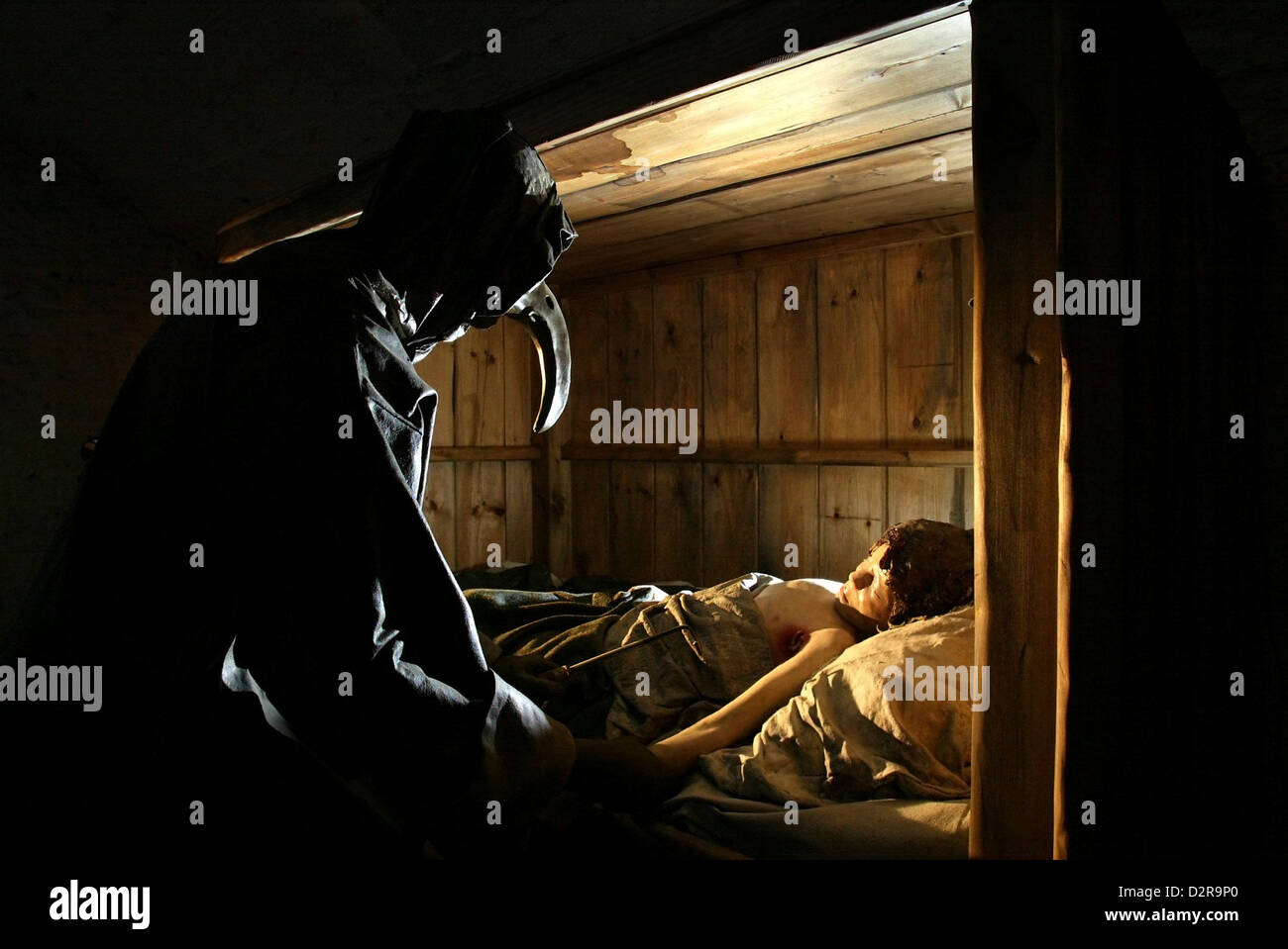 The Plague doctor attends a patient in the Plague room at the Real Mary King's Close tourist attraction in Edinburgh, - Stock Image