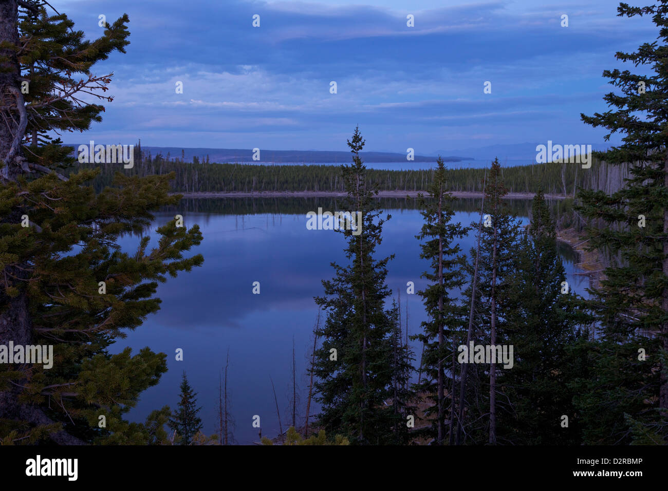 View of Duck Lake and Yellowstone Lake at dusk from near West Thumb, Yellowstone National Park, Wyoming, USA - Stock Image