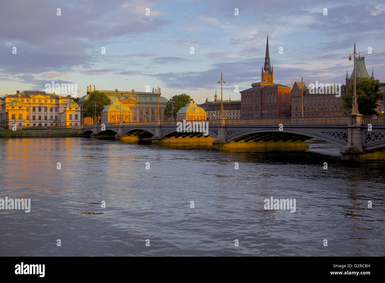 Gamla Stan and Riddarholmen with spire of Riddarholmskyrkan (Riddarholmen Church) on the skyline at sunset, Stockholm, - Stock Image