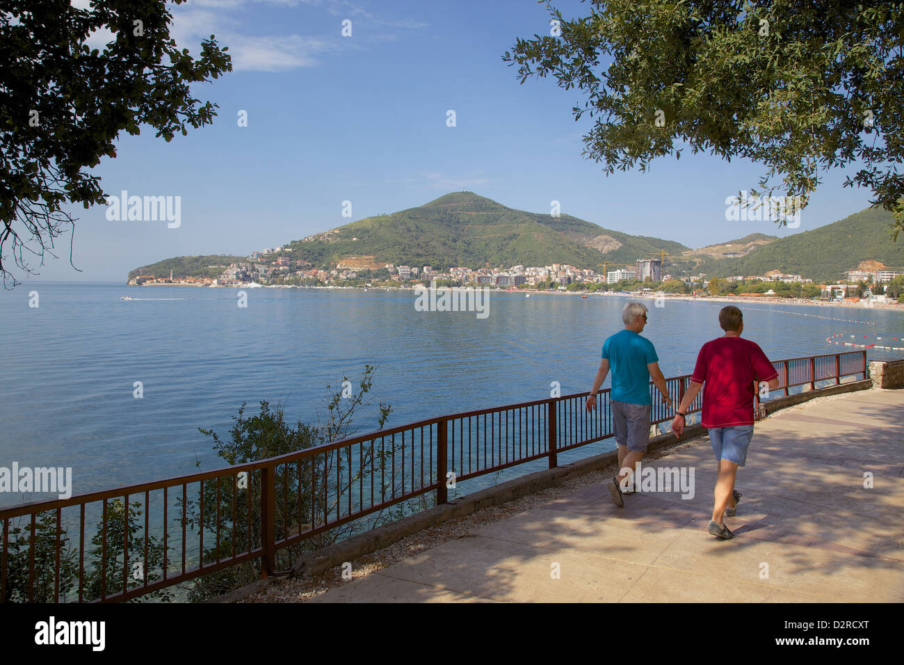 Walkers and Old Town, Budva Bay, Montenegro, Europe - Stock Image