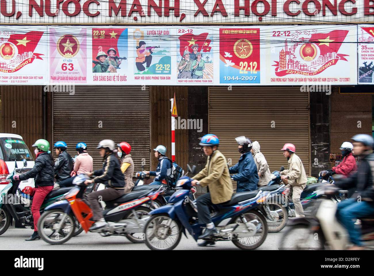 Unidentified men and women drive their motorcycles on January 14, 2008 in Hanoi, Vietnam. Stock Photo