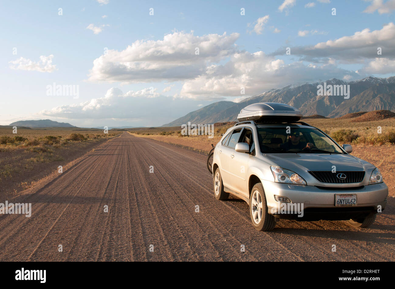 4WD car travels on a dirt road on a road trip through Owens Valley,  California near Bishop on the way to Red Canyon - Stock Image