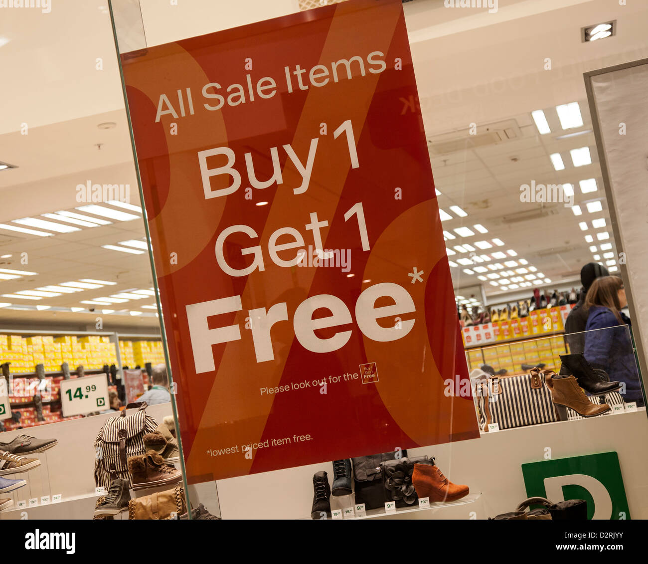 All Sale items Bogof_ Buy one get one free_ Signs in shop in Shopping Centre, Blackpool Store, Lancashire, UK - Stock Image