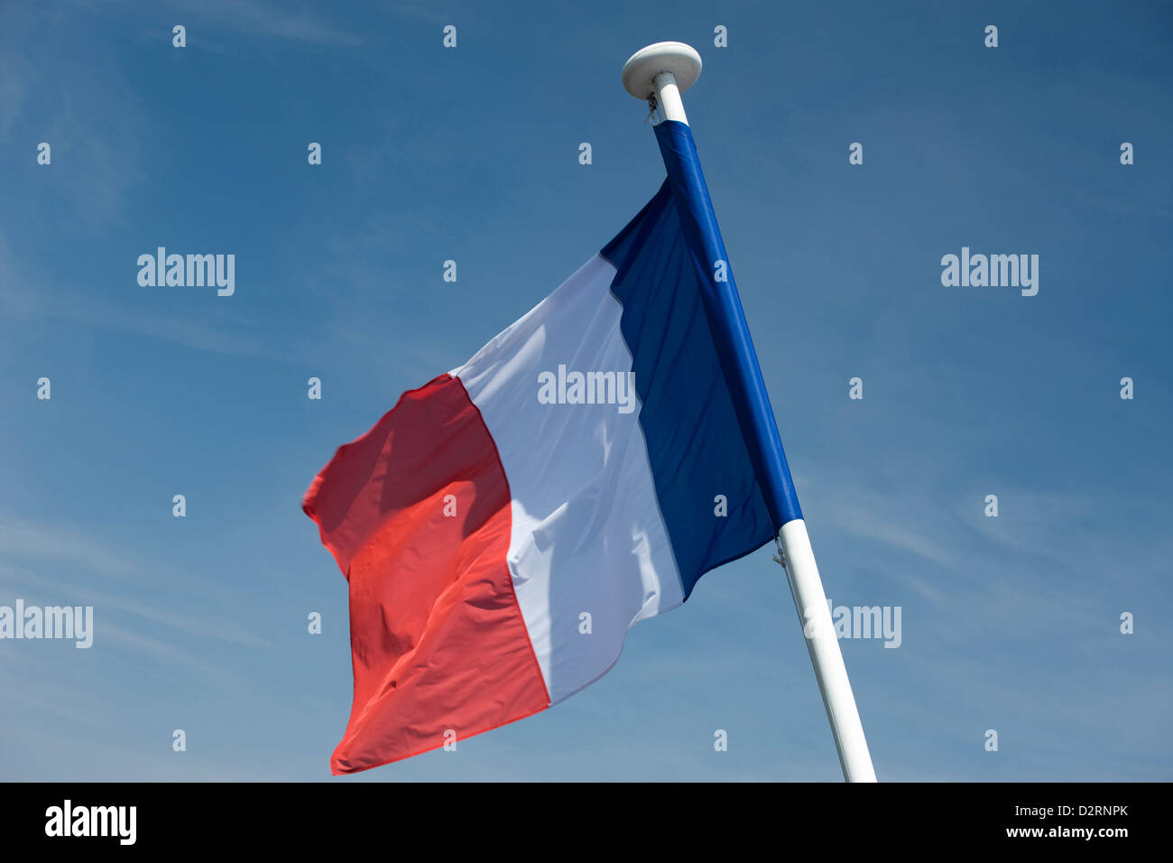 FRENCH FLAG FLYING ON FLAGPOLE - Stock Image