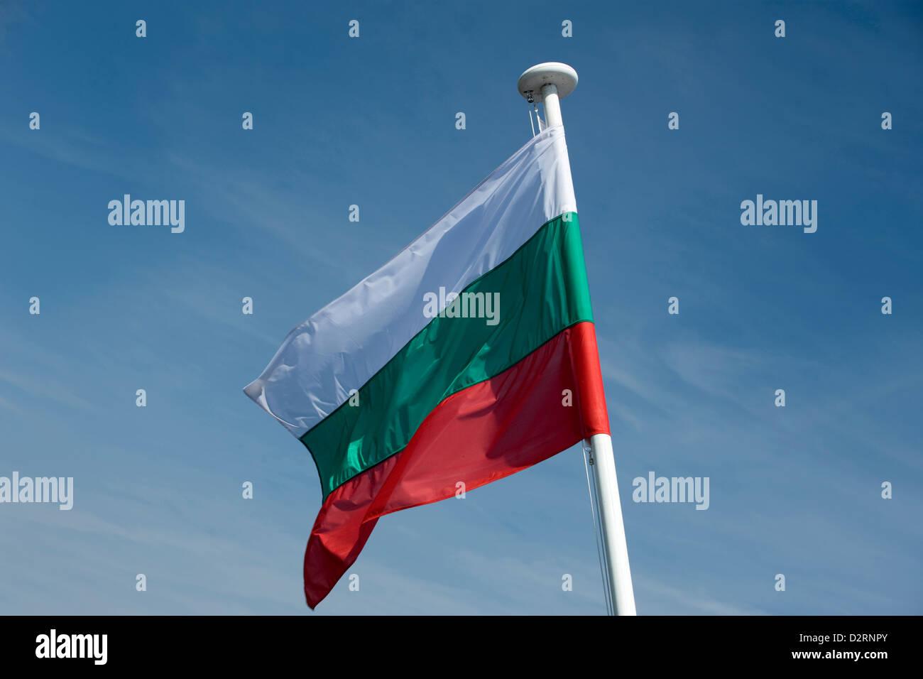 BULGARIAN FLAG FLYING ON FLAGPOLE - Stock Image