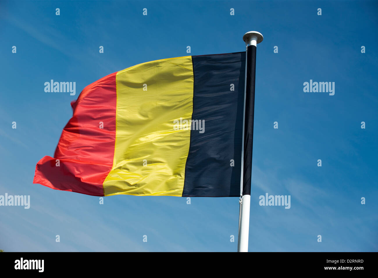 BELGIUM FLAG FLYING ON FLAGPOLE - Stock Image