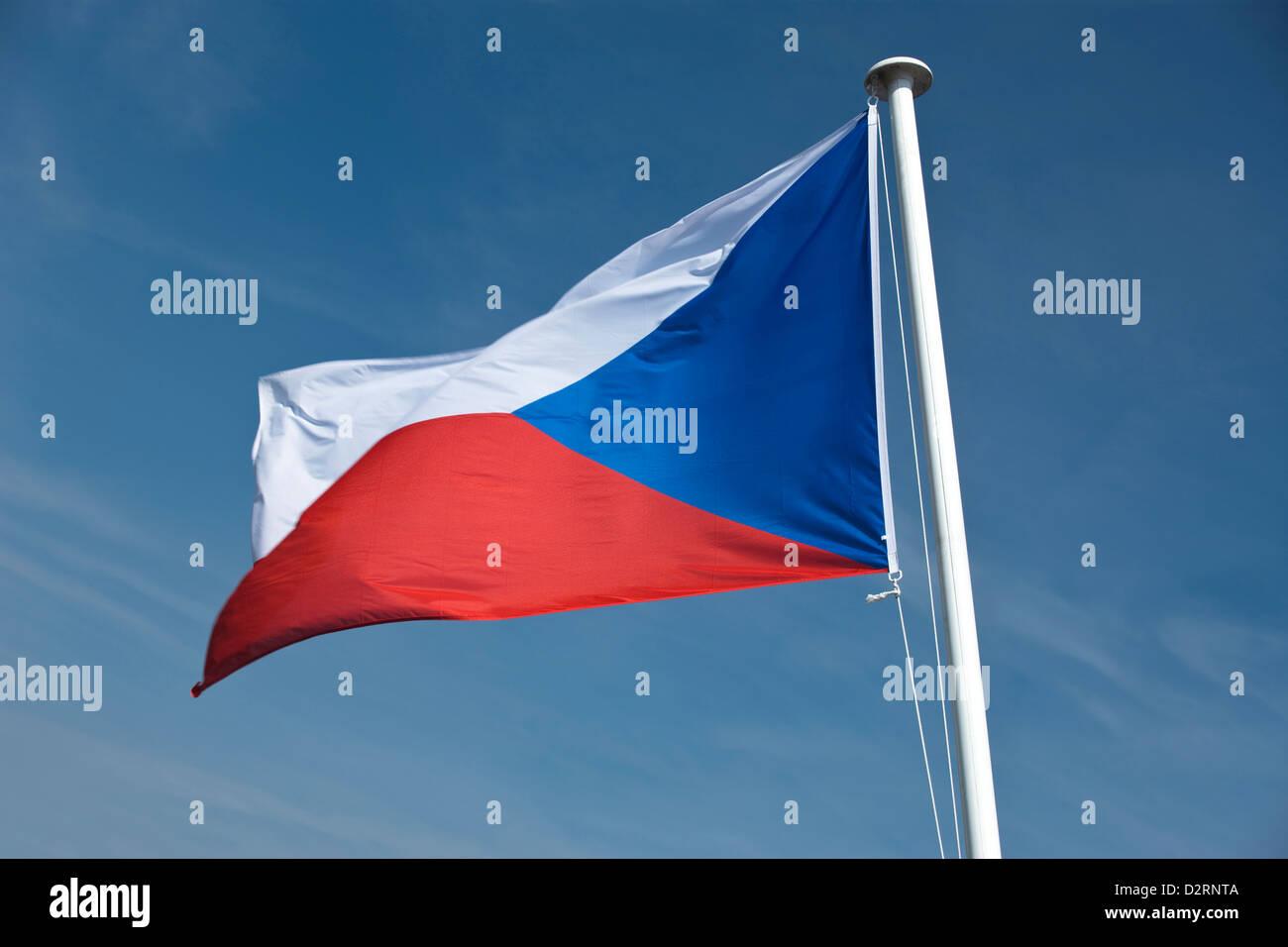 CZECH REPUBLIC FLAG FLYING ON FLAGPOLE - Stock Image