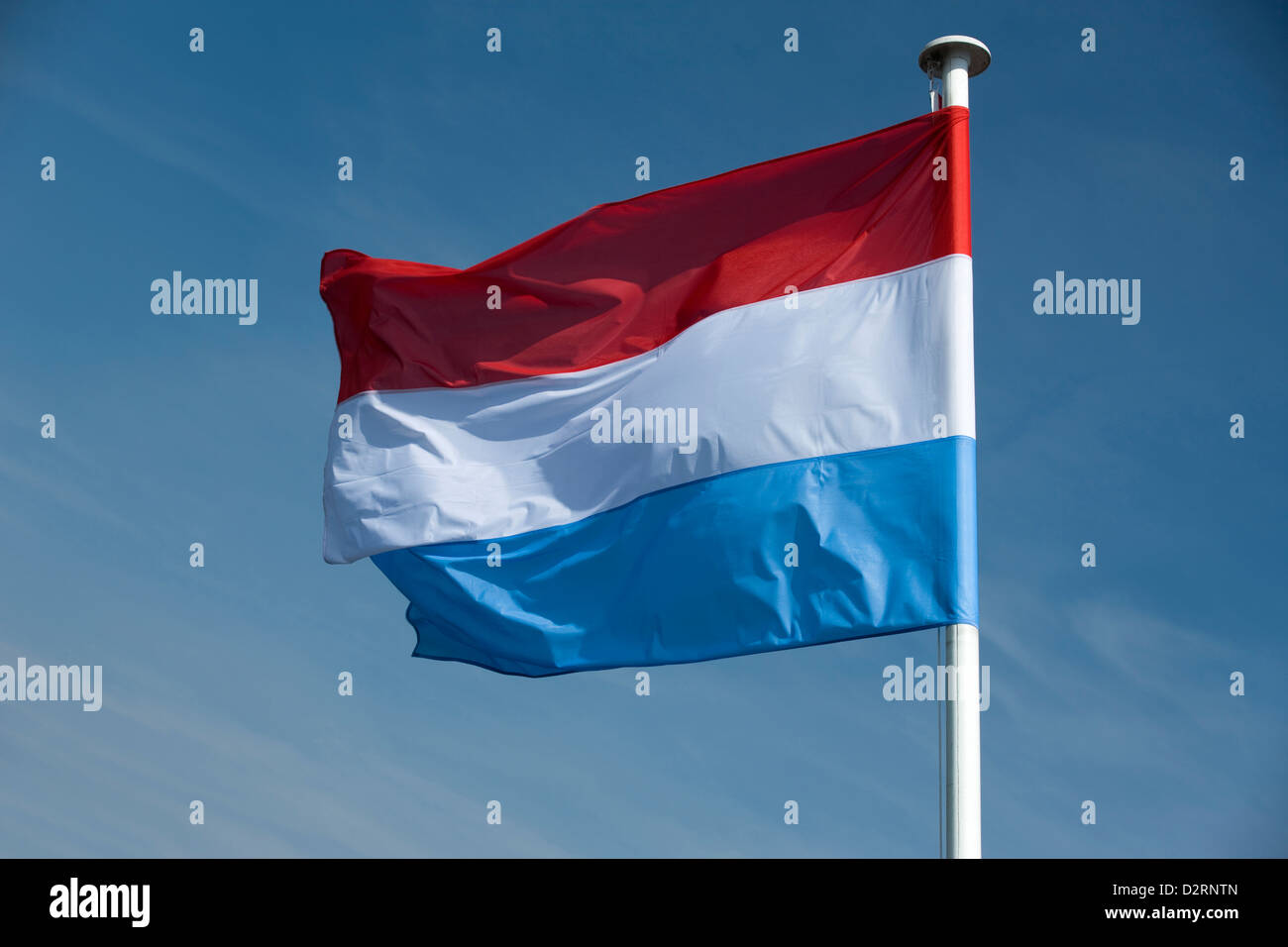 DUTCH FLAG FLYING ON FLAGPOLE - Stock Image