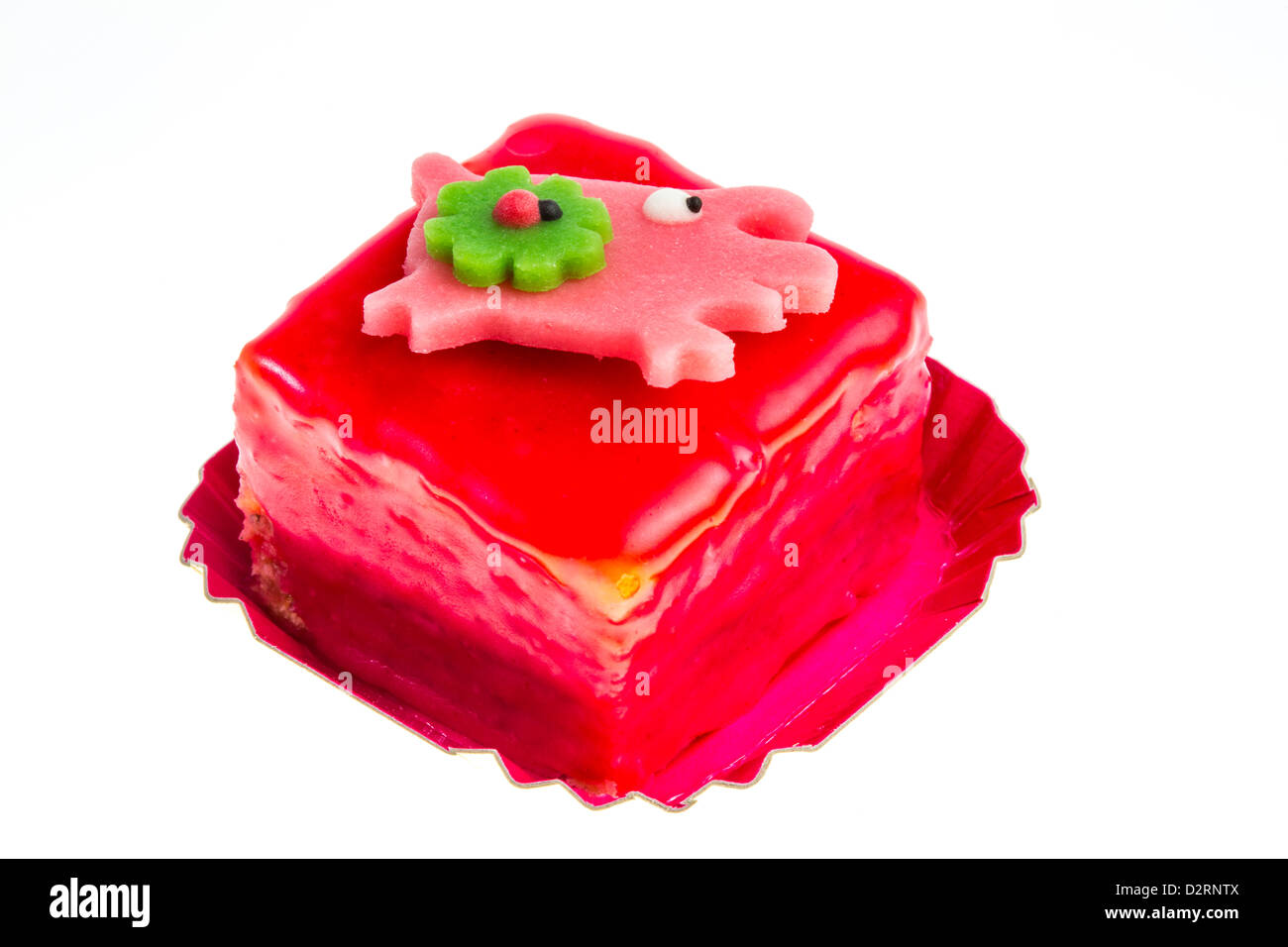 Petit Fours, little, small cakes. Sweet, dyed, with lucky charm symbolic decoration. Stock Photo
