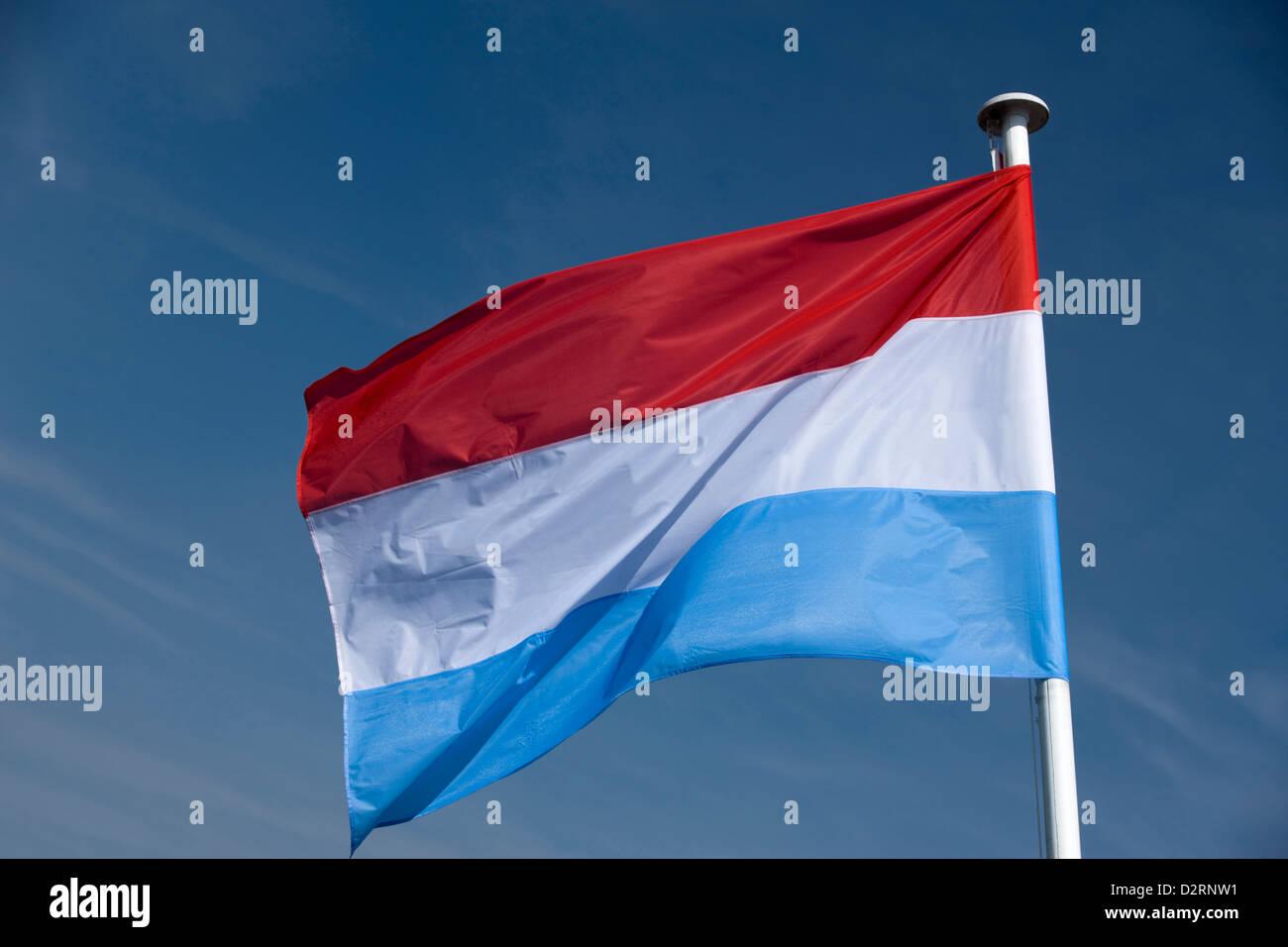 DUTCH FLAG FLYING ON FLAGPOLE - Stock Image