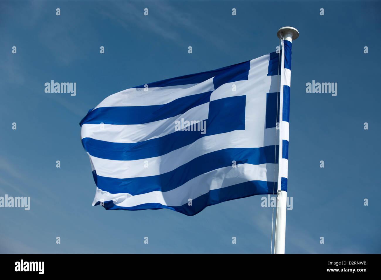 GREEK FLAG FLYING ON FLAGPOLE - Stock Image