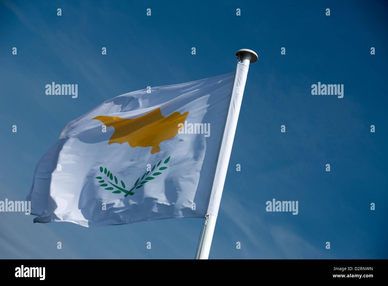 REPUBLIC OF CYPRESS FLAG FLYING ON FLAGPOLE - Stock Image
