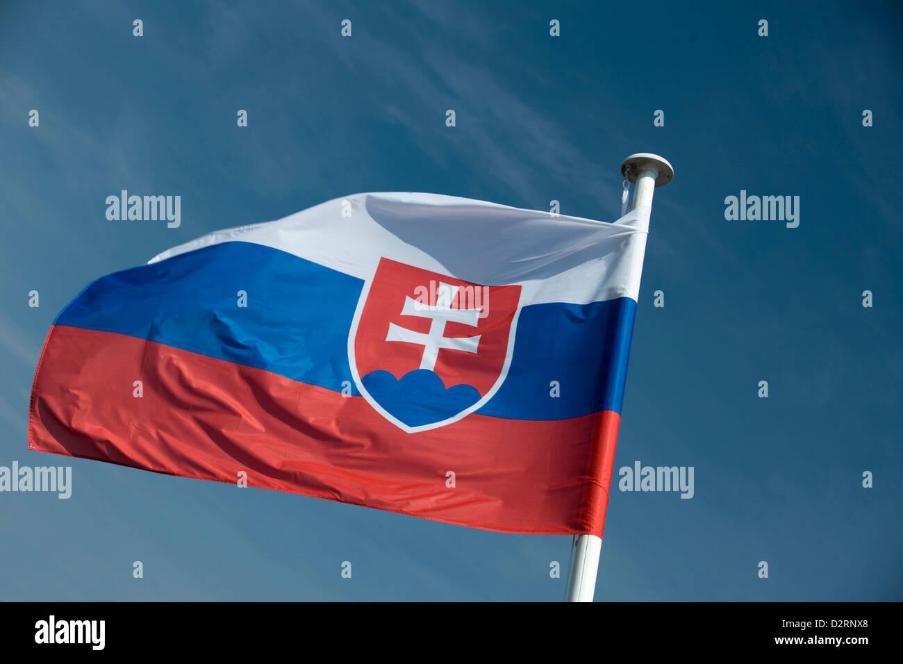 SLOVAKIAN FLAG FLYING ON FLAGPOLE - Stock Image