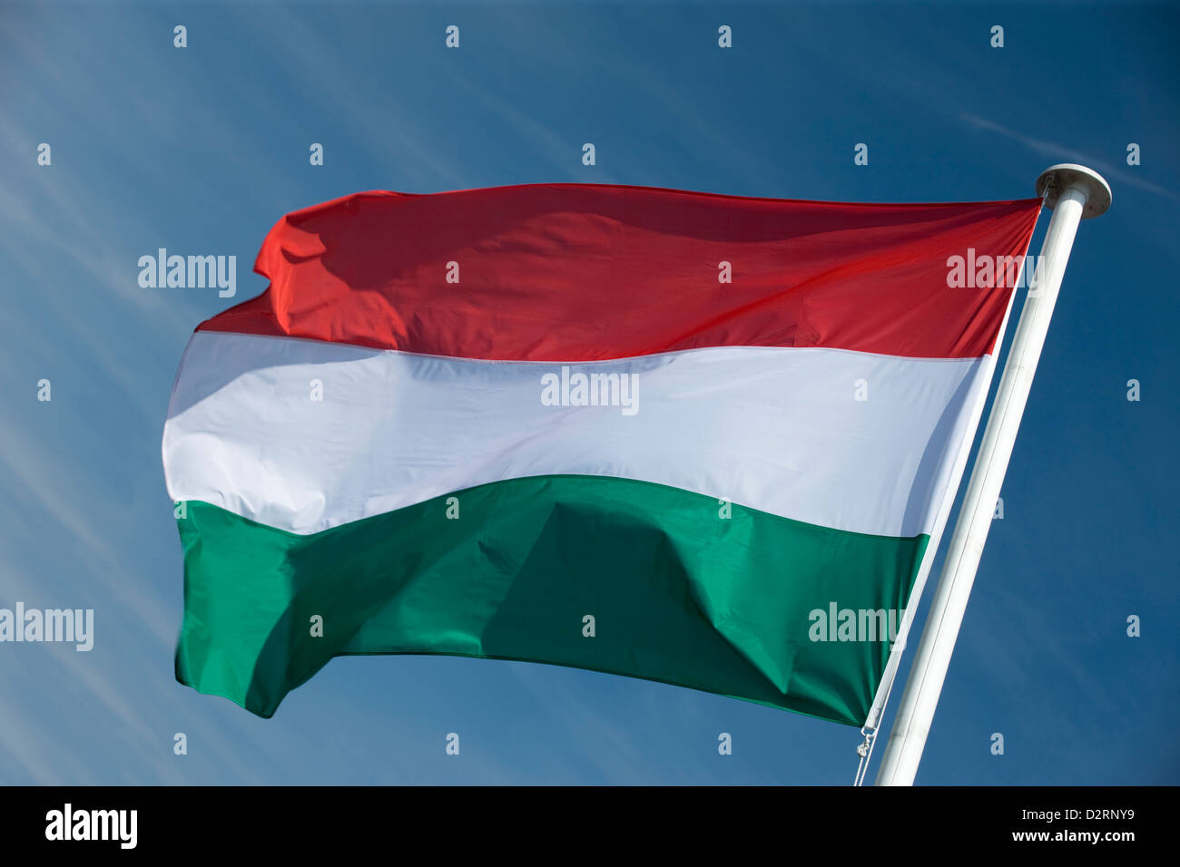 HUNGARIAN FLAG FLYING ON FLAGPOLE - Stock Image