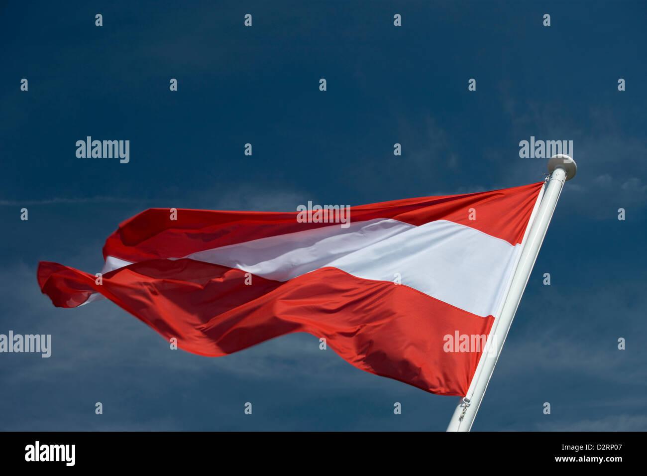 AUSTRIAN FLAG FLYING ON FLAGPOLE - Stock Image