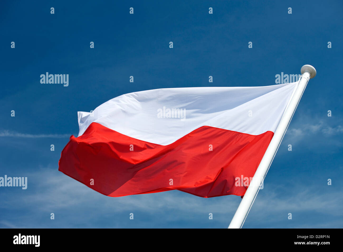 POLISH FLAG FLYING ON FLAGPOLE - Stock Image