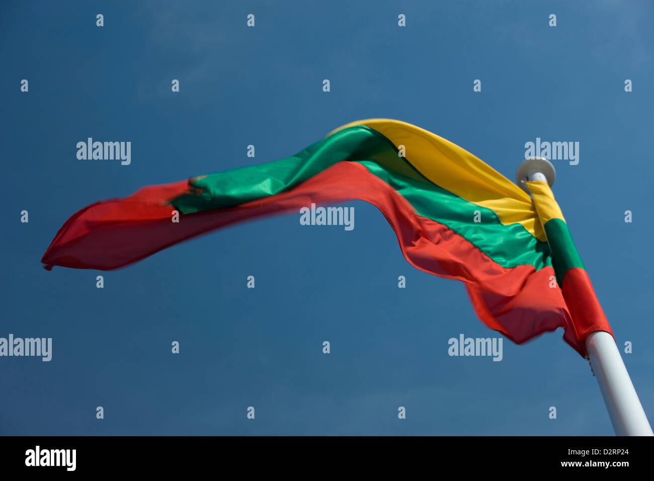 LITHUANIAN FLAG FLYING ON FLAGPOLE - Stock Image