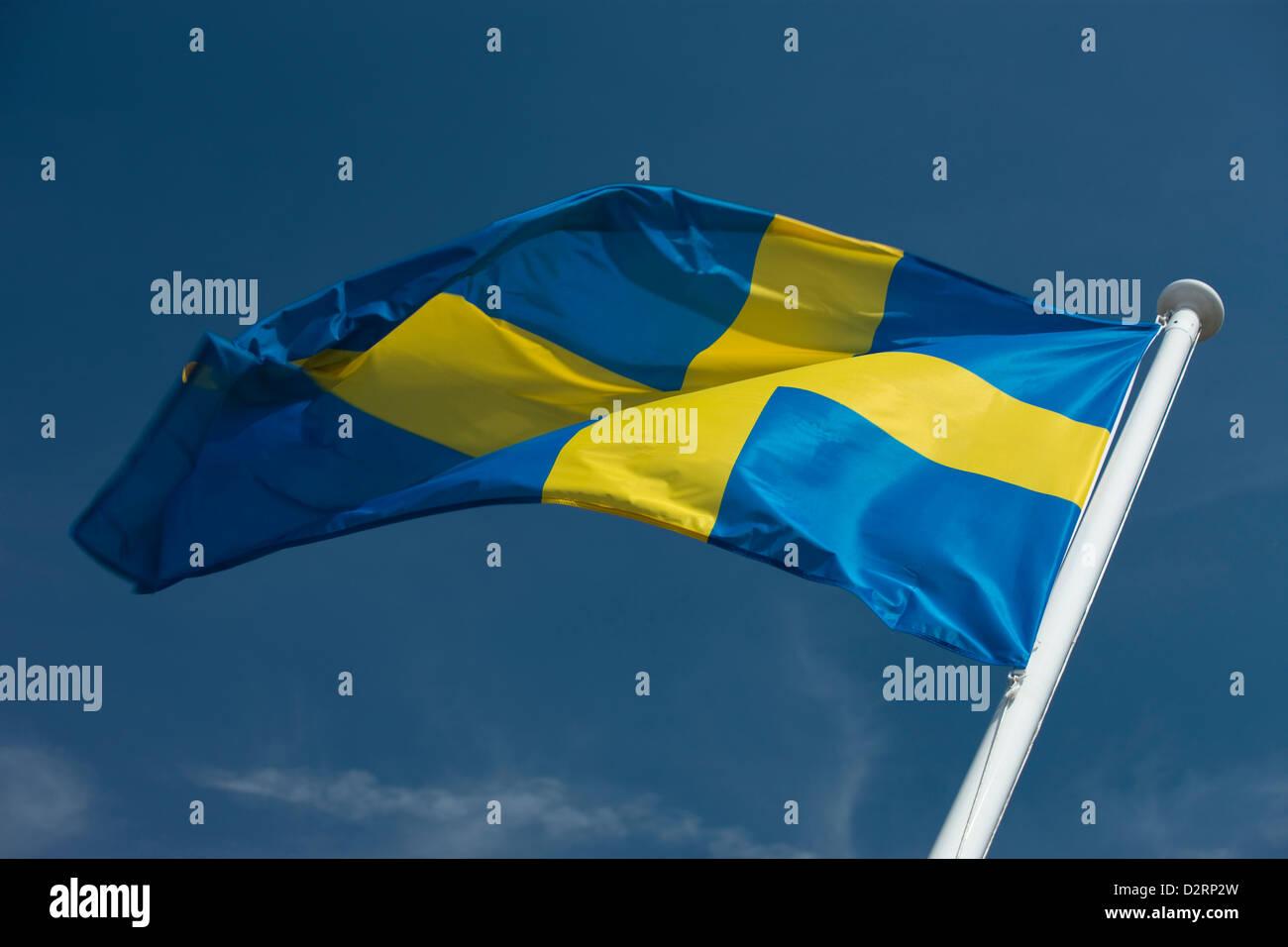 SWEDISH FLAG FLYING ON FLAGPOLE - Stock Image