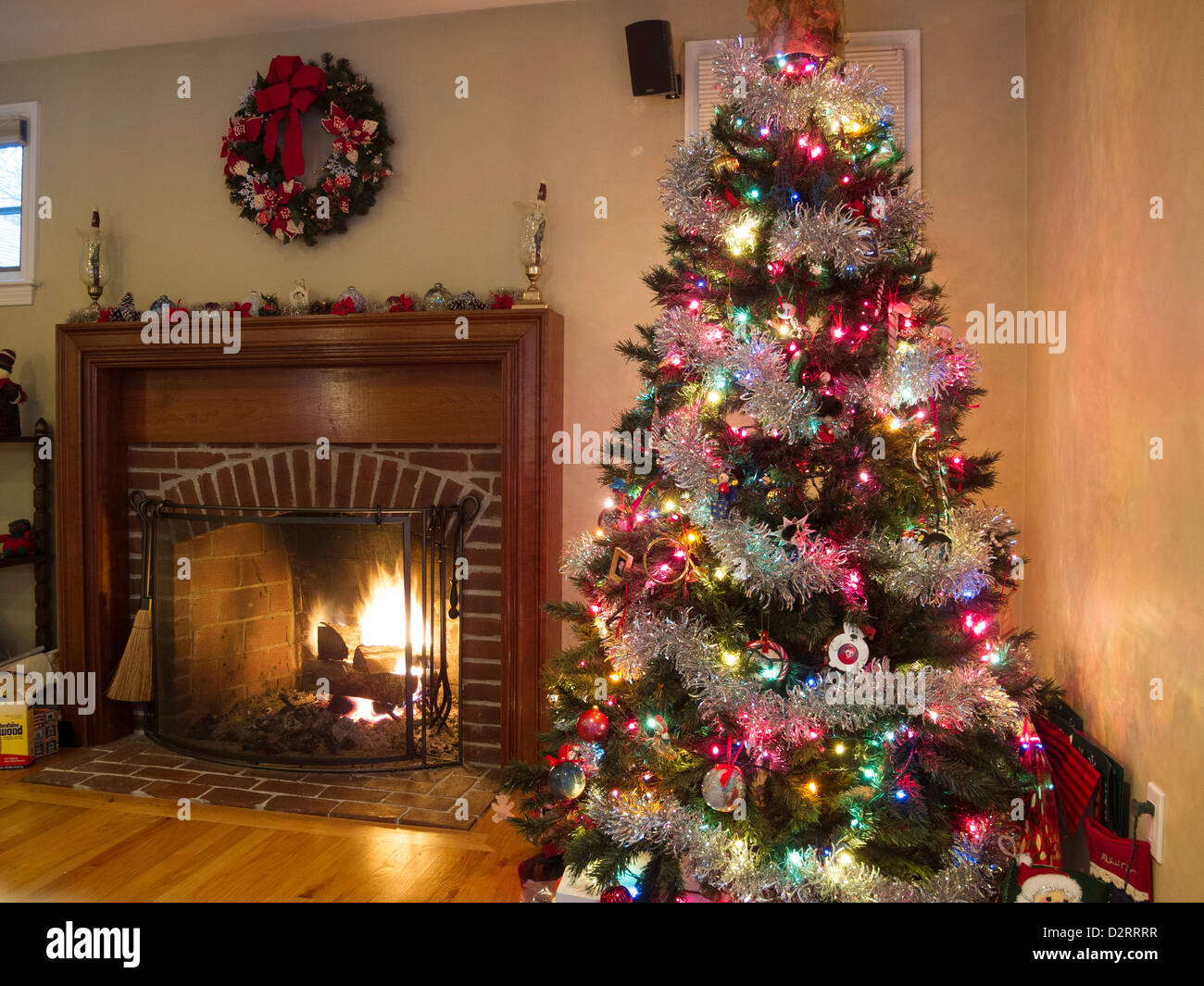 christmas tree and fireplace in a residential home usa. Black Bedroom Furniture Sets. Home Design Ideas