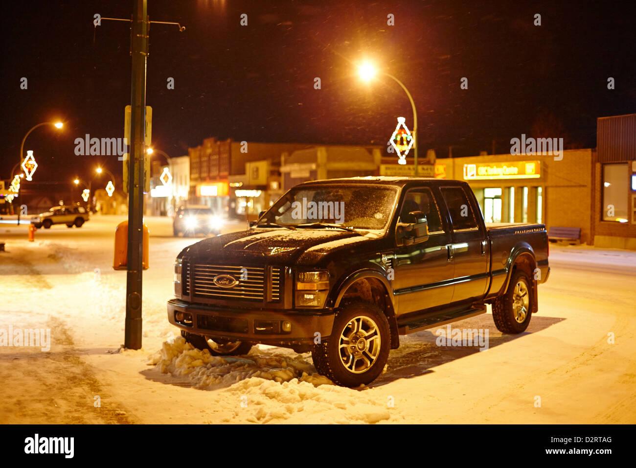 truck parked on the main street at night in snowstorm Biggar Saskatchewan Canada - Stock Image