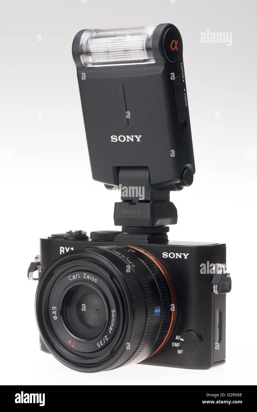 Sony Cyber-shot RX1 full frame digital camera. Attached accessory flash. - Stock Image