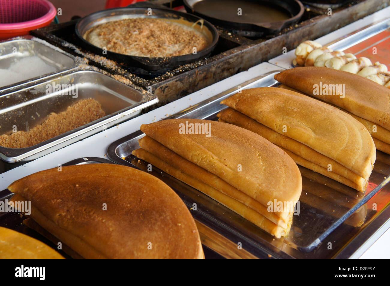 Apam balik (turnover pancake) Malaysian version of pancake with filling of sugar, peanuts and creamy sweet corn - Stock Image
