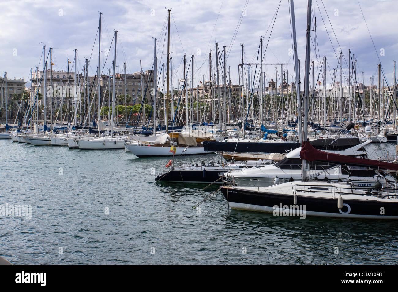 Sailboats in Barcelona harbor Port Vell - Stock Image