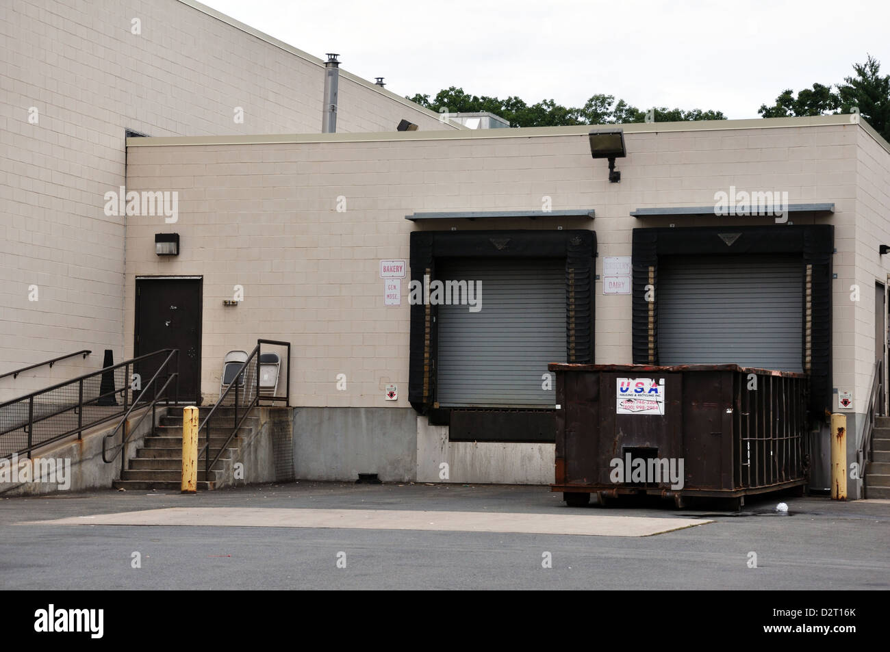 Loading dock with truck bays in the back of the store ...