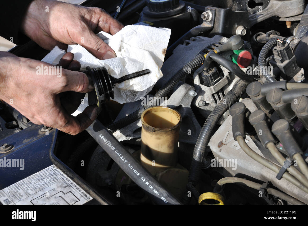 Man Working On His Car Checking Power Steering Fluid Level Stock Photo Alamy