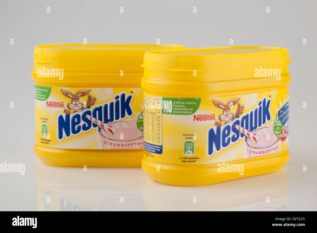 Two containers of Nestle Strawberry flavour Nesquick milkshake mix - Stock Image