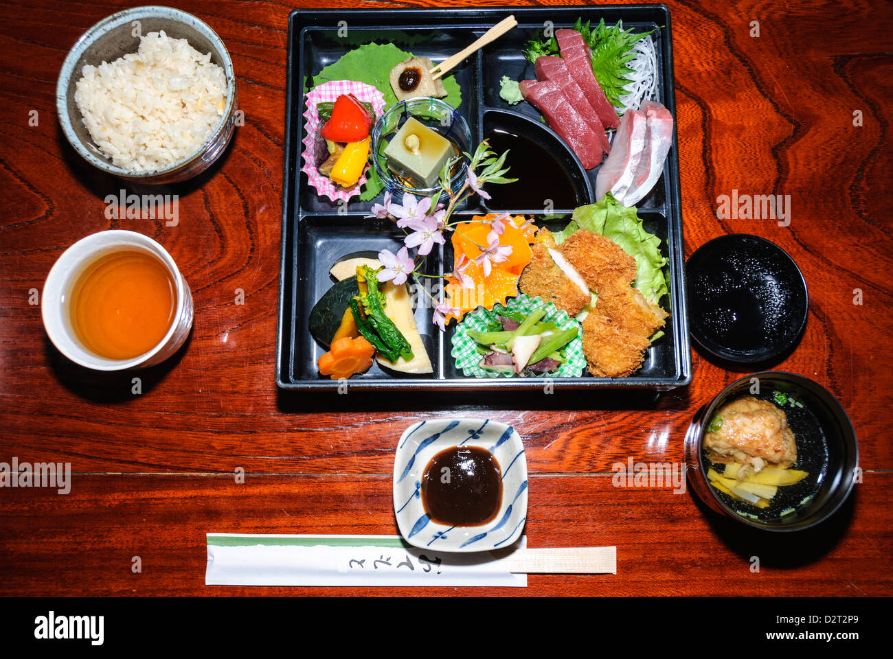 Food in Japan: a traditional Japanese meal, home cooked by the owner of the ryokan. - Stock Image