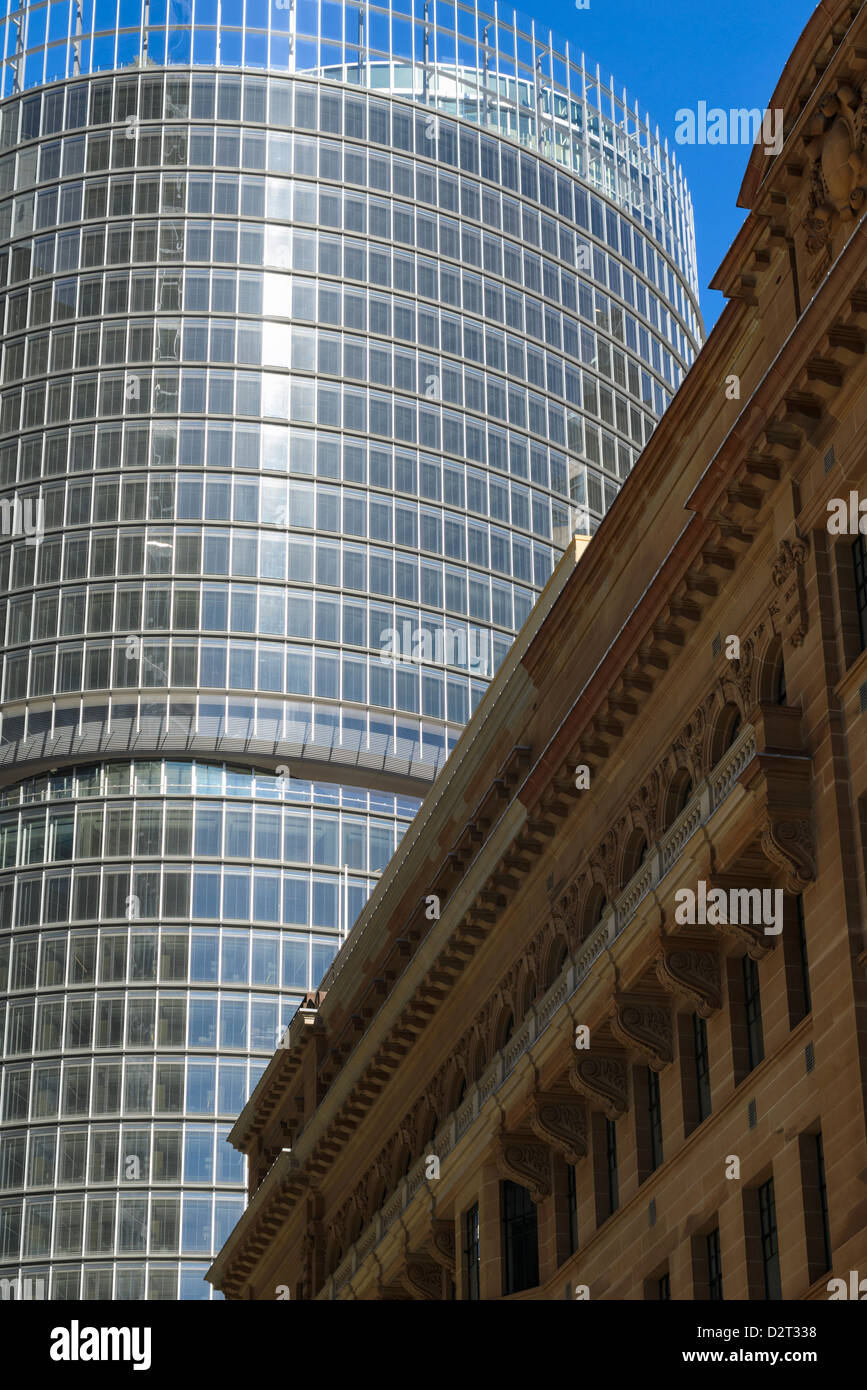 Architectural contrasts: traditional sandstone versus modern environmentally sustainable glass and metal style - Stock Image