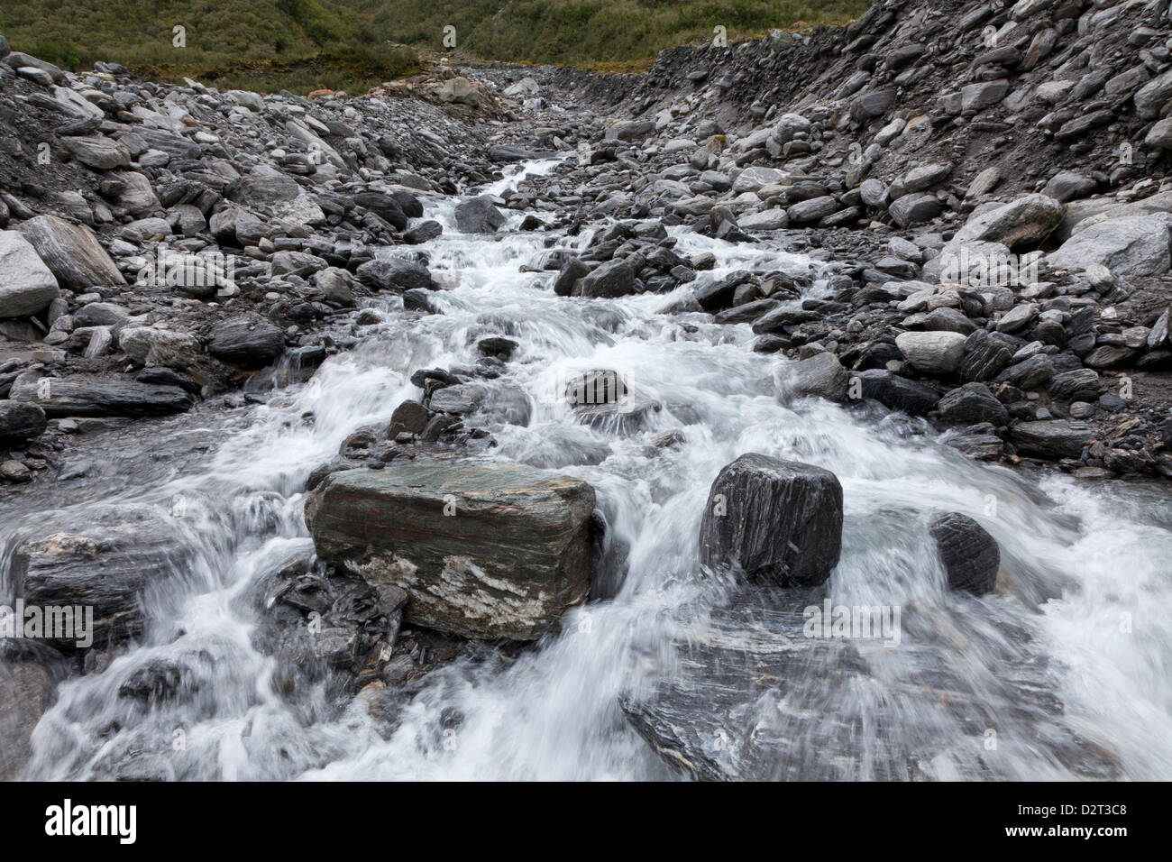 Water streaming from Fox Glacier, Southern Island, New Zealand - Stock Image